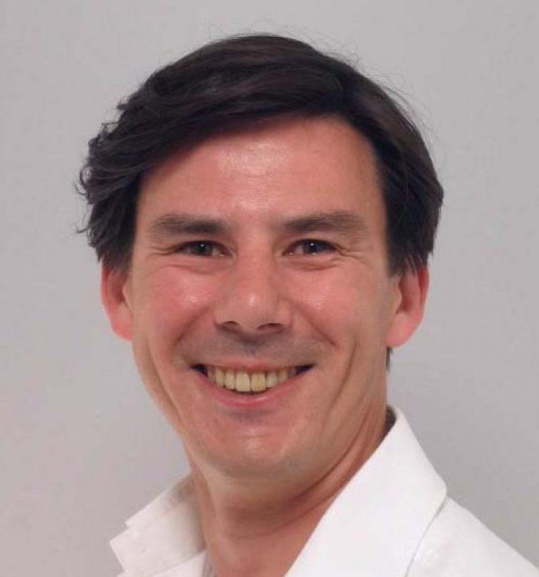 Dr. Carlos Vrins
