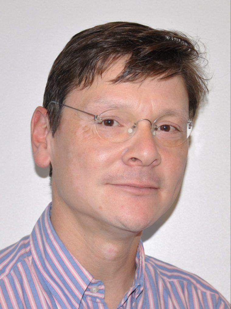 Dr. Robert F. Pangalila